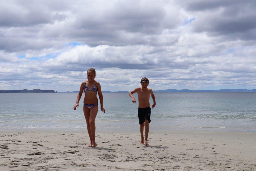 Go Wild kids on beach at Adventure Bay, Bruny Islsnd, Tasmania.