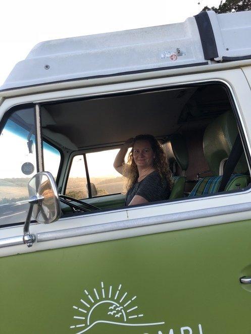 Danielle driving her dream car.